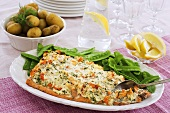Baked salmon with shrimps, mangetout and potatoes