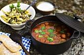 Lamb stew, garlic yoghurt and bean salad