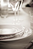 Place-setting and wine glasses (black and white photo)