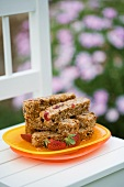 Fruity muesli bars on wooden chair