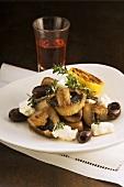 Warm mushroom salad with olives and feta