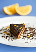 Piece of chocolate cake with orange zest