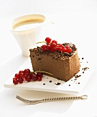 Piece of chocolate cheesecake with redcurrants