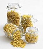 Various types of pasta in storage jars