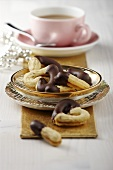 Chocolate-dipped piped biscuits with coffee (Christmas)