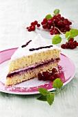 Piece of coconut cream cake with redcurrants