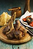 Grilled meat and vegetables, seasonings, bread