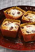 Small cherry and almond cakes with icing sugar