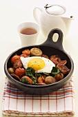 Pan-cooked chorizo, mushrooms, tomatoes and fried egg