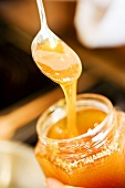 Honey on spoon and in jar