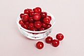 Cowberries in a small glass dish