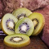 Slices of kiwi fruit on bricks