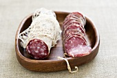 Saucissons in wooden dish