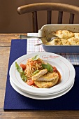 Parmesan-coated turkey escalopes, spaghetti and tomato sauce