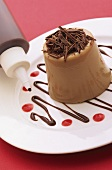 Chocolate dessert with chocolate sauce from a plastic bottle