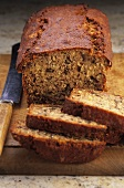 Banana and pecan bread, partly sliced