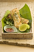 Deep-fried rice paper rolls with fish filling