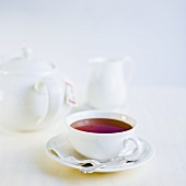 Cup of tea, teapot and cream jug