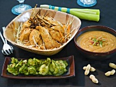 Chicken satay with peanut dip and cucumber salad
