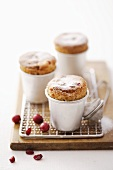 Cranberry soufflés with icing sugar