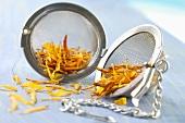 Dried marigold petals in a tea infuser