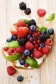 Fresh berries and basil on bread