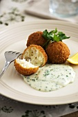 Fish and potato balls with parsley sauce