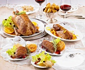 Various duck dishes on laid table