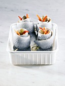 Several rollmops in plastic container