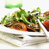 Salad leaves with anchovies, tomatoes and vinaigrette