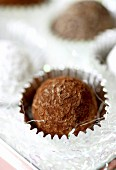Chocolate truffles in silver foil cases (close-up)