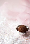 Chocolate truffle in silver foil case