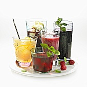 Five different types of compote in glasses