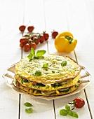 Savoury pancake cake with vegetables and basil