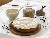 Coffee cake with cinnamon cream on wooden board