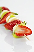 Strawberries, kiwi fruit and banana on skewer