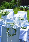 Laid wedding table in garden