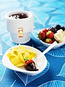 Chocolate fondue with mango, strawberries and banana