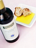 Olive oil, bread and bottle of red wine