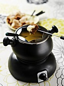 Cheese fondue with cubes of bread