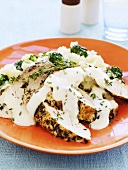 Chicken with thyme, cream sauce, broccoli and mashed potato