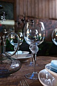 Carafe and wine glasses on table