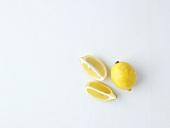 Whole lemon and lemon wedges