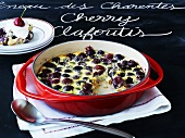 Cherry clafoutis on slate menu board