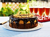 Black and tan cake with chocolate icing and nuts