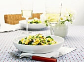 Pasta with peas, cheese & leafy vegetables, glasses of white wine
