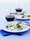 Ravioli with pancetta and rosemary, glasses of red wine