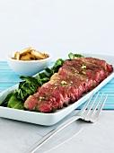 Porterhouse steak (rare), sliced, with spinach & fried mushrooms