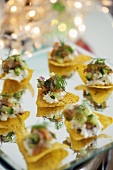 Nachos with soft cheese and smoked salmon