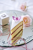 A piece of wedding cake with butterfly decoration